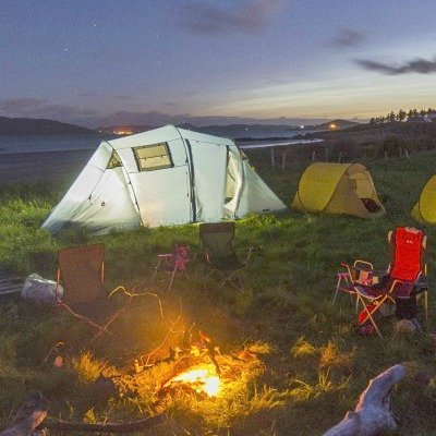 tents and chairs with a campfire