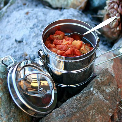 cooking pot with food on rocks