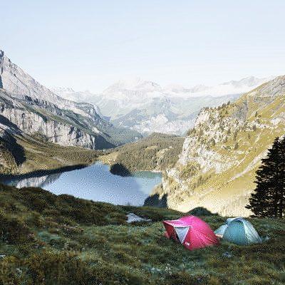 tents overlooking mountain scene