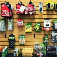 camping and backpacking accessories on a wall